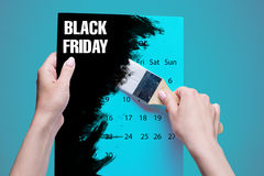 Black Friday sale - holiday shopping concept. Text on note book on black. The female hands holding painting brush stock photos