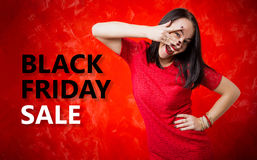 Black Friday Sale poster. With woman in red dress stock images