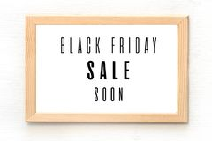 Black Friday sale poster in wooden frame hanging on the wall. Vector illustration royalty free illustration