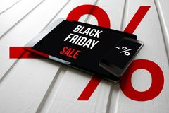 Black friday sale promotion on computer tablet screen, on white Stock Photo