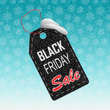 Black Friday sale realistic paper price tag on background with snow and snowflakes. Stock Photography
