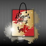 Black friday sale red shopping bag with gold brushes and light effect on background. Vector illustration. stock illustration