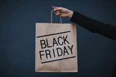 Black Friday sale. Shopper holding paperbag with sign of Black Friday Royalty Free Stock Images