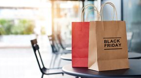 Black Friday sale and shopping bags on tables front of mall. Black Friday sale and shopping bags on tables front of shopping mall store background, business Royalty Free Stock Photo