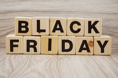 Black friday sale shopping concept alphabet on wooden background Royalty Free Stock Photography