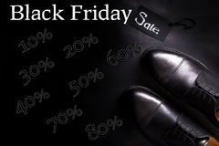 Black friday. Sale sign.  oxford shoes on  background. Top view. Black friday. Sale sign. Black oxford shoes on black background. Top view Stock Photography