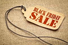 Black Friday sale sign on paper price tag. Black Friday sale sign - a paper price tag with a twine against burlap canvas royalty free stock images