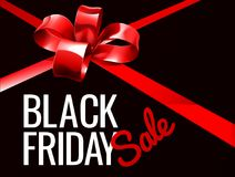 Black Friday Sale Sign. A red gift bow ribbon Black Friday Sale sign Stock Photo