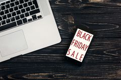 Black friday sale. special offer discount text on mobile phone s Royalty Free Stock Images