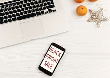 Black friday sale. special offer discount text on mobile phone s Stock Photo