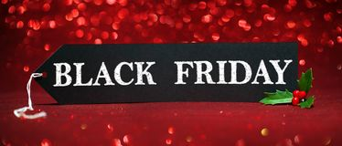 Black Friday sale tag. On red glitter background royalty free stock photos