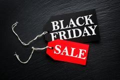 Black Friday Sale tag. S on dark background Stock Photos