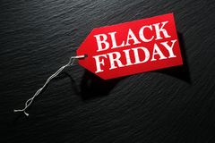 Black Friday Sale tag. On dark background royalty free stock photos