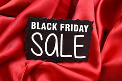 Black Friday Sale Tag with red Silk Background Stock Images