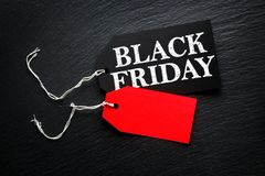 Black Friday Sale tag on dark background Royalty Free Stock Images