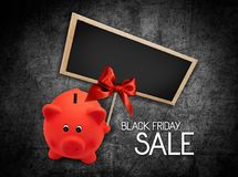 Black Friday sale text blackboard and piggy bank with red ribbon vector illustration