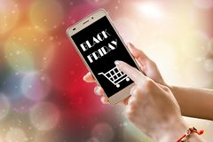 Black friday sale text on hand holding smart phone. royalty free stock images