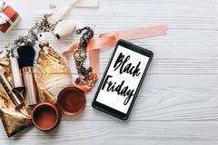 Black friday sale text sign on screen phone and luxury jewelry. Perfume and watch and makeup on white background with space for text. flat lay. fashion blogger stock images