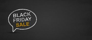 Black friday sale word in speech bubble on a blackboard royalty free stock photo