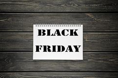 Black Friday sales  Advertising Poster on Black Wooden background Stock Images