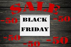 Black Friday sales Advertising  Poster on Black Wooden background Stock Image