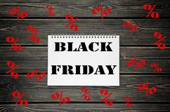 Black Friday sales  Advertising Poster on Black Wooden background Stock Photography
