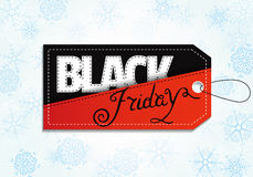 Black Friday sales tag on snowflake background. Royalty Free Stock Photography