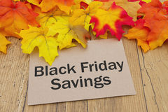 Black Friday Savings Card. Autumn Leaves on weathered grunge wood with a Black Friday Deals  Savings Stock Image