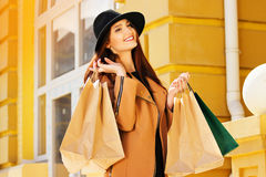 Black Friday shopping. Attractive and cheerful girl walking the city with shoppings. Shopping concept. Royalty Free Stock Image