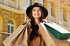 Black Friday shopping. Attractive and cheerful girl walking the city with shoppings. Shopping concept. Royalty Free Stock Images