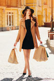 Black Friday shopping. Attractive and cheerful girl walking the city with shoppings. Shopping concept. Stock Photo