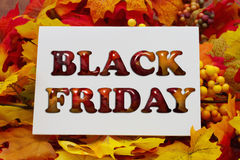 Black Friday Shopping. Autumn Leaves with a white greeting card with text Black Friday Stock Image