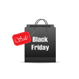 Black friday on shopping bag with red sale label. Black paper shopping bag with inscription Black Friday and Sale on red label,  on white background Stock Photography