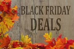 Black Friday Shopping Deals. Autumn Leaves with grunge wood with text Black Friday Deals Royalty Free Stock Photo