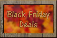 Black Friday Shopping Deals. Weathered wood frame with leaves background with text Black Friday Deals Royalty Free Stock Photo