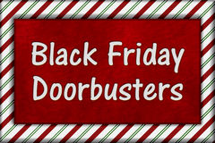Black Friday Shopping Doorbusters. Candy Cane Striped Frame with plush red background with text Doorbusters Royalty Free Stock Photo