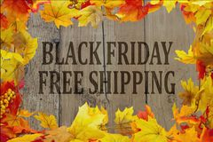 Black Friday Shopping Free Shipping. Autumn Leaves with grunge wood with text Black Friday Free Shipping Royalty Free Stock Images
