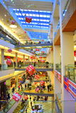 Black friday shopping mall. A shopping mall with Christmas decorations filled with customers on Black Friday, start the holiday shopping season.Picture taken on Royalty Free Stock Image