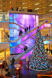Black Friday Shopping. This shopping mall is ready for christmas the day after thanksgiving. Photo of christmas tree and colorful escalator at a mall in Royalty Free Stock Photos