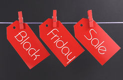 Black Friday shopping sale concept with message written across red ticket sale tags Stock Photos
