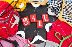 Black Friday shopping sale concept with red Sale tag and clothes Royalty Free Stock Photo