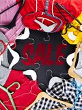 Black Friday shopping sale concept with red Sale tag and clothes Stock Images