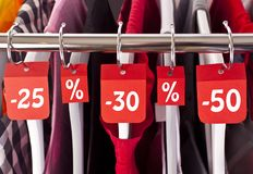 Black Friday shopping sale concept. Sale in a clothing store - discount sign at a clothes rack Royalty Free Stock Photography