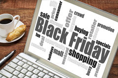 Black Friday shopping. Word cloud on a laprop computer with a cup of coffee Royalty Free Stock Photography