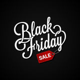 Black Friday sign with sale tag on dark background Royalty Free Stock Photo