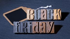 Black Friday Sign. Black friday text with blank price tag on a black background Royalty Free Stock Photo
