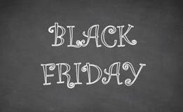 Black Friday som är skriftlig med krita på svart tavla Royaltyfri Foto