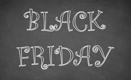 Black Friday som är skriftlig med krita på svart tavla Fotografering för Bildbyråer