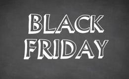 Black Friday som är skriftlig med krita på svart tavla Royaltyfri Bild