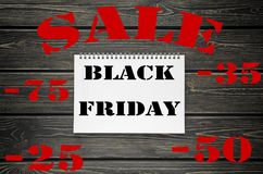 Black Friday sprzedaże Reklamuje plakat na Czarnym Drewnianym tle obraz stock